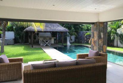 Villa à Grand Baie - vue séjour et jardin - PLEION Private Services